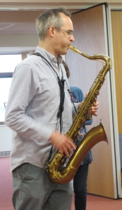 Josh Kemp playing a saxophone