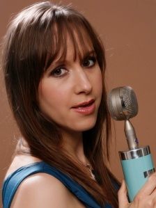 Ruth Applin singing into a microphone