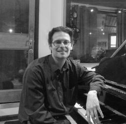 Tutor Nick Tomalin at the piano